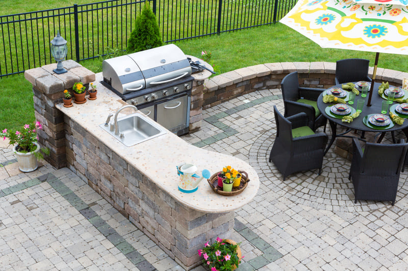 A beautiful outdoor kitchen design with landscaping